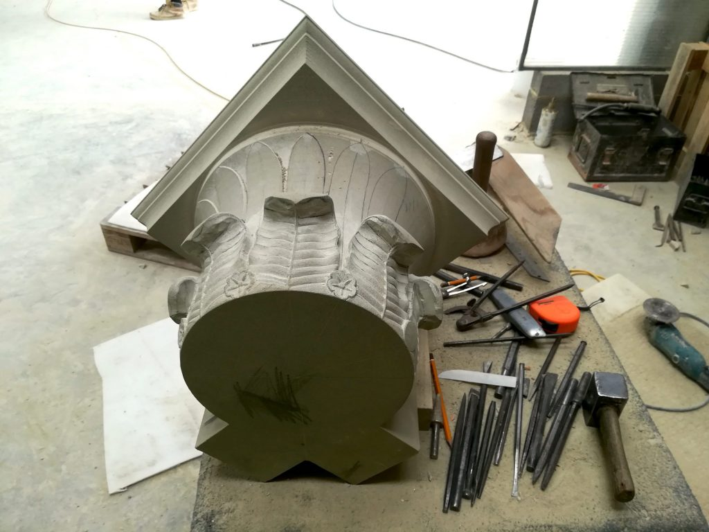 Traditional stone carved column capital