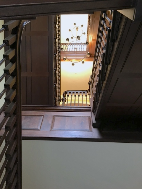 Dark timber bespoke staircase in country house stairwell