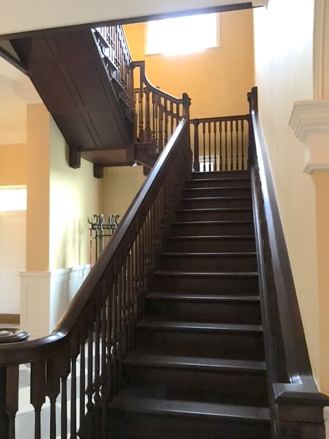 Large dark Oak staircase in house hall