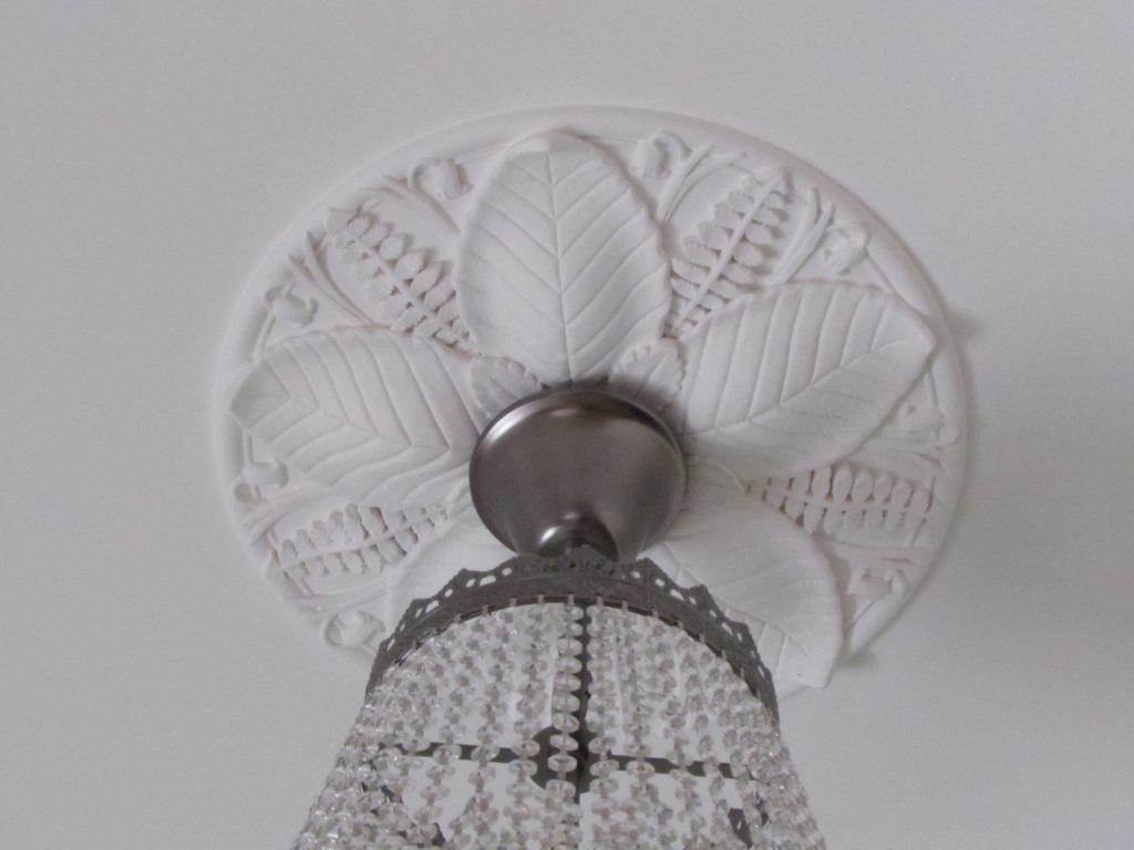 Bespoke plaster ceiling rose for chandelier in bedroom