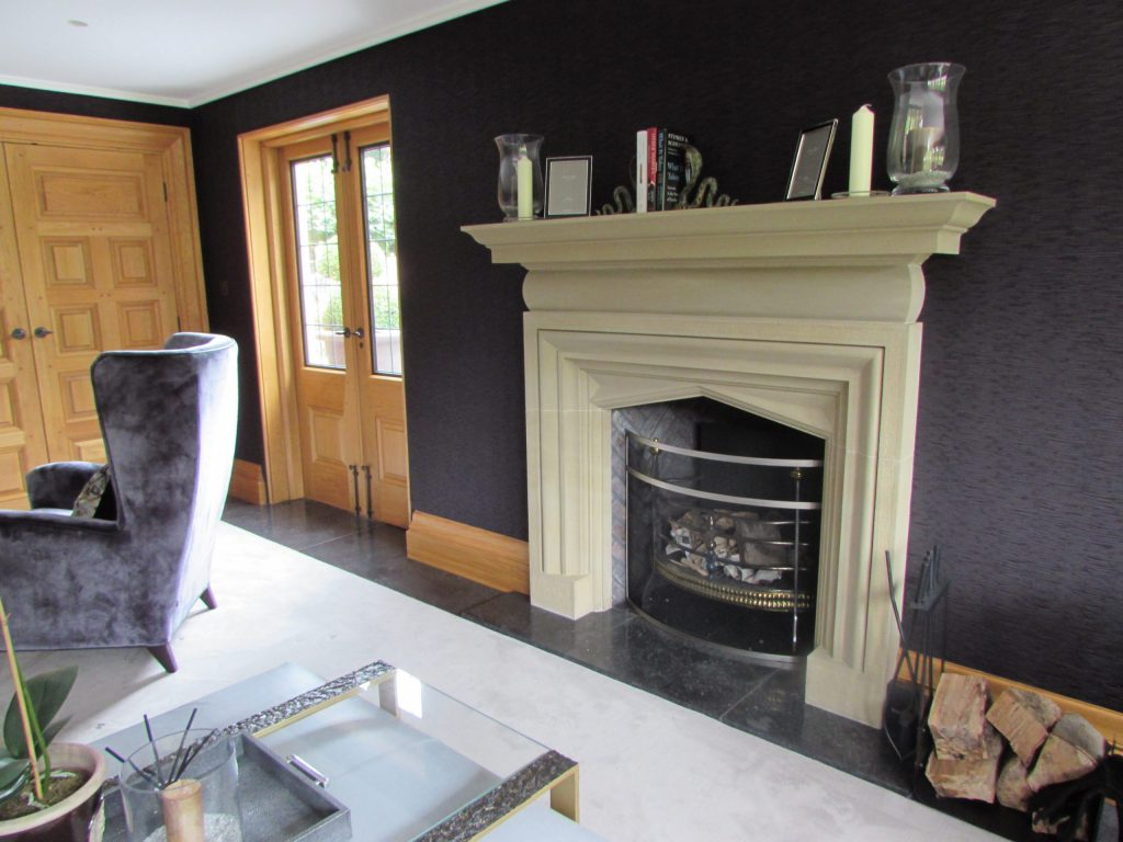 Bespoke stone fireplace surround in country house