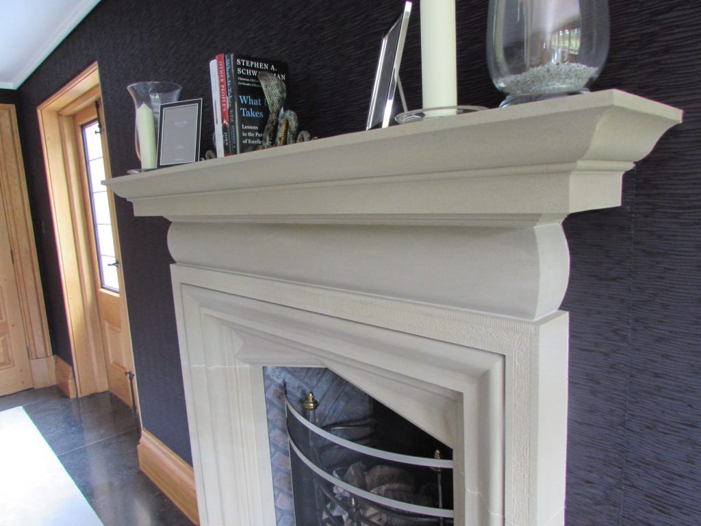 Arts and Crafts stone fireplace in English Manor House
