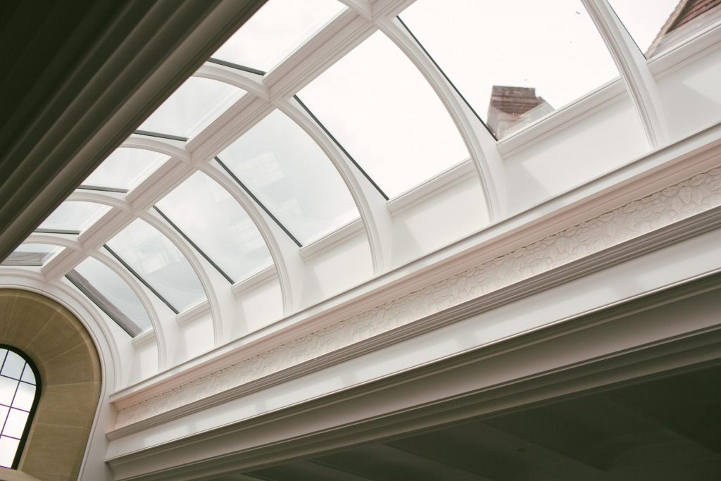 Classical orangery glass roof with plasterwork decoration