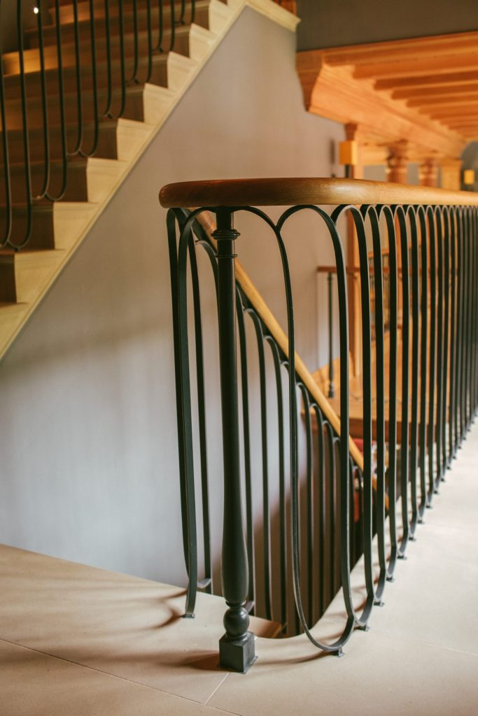Bespoke stone staircase with metal and Oak handrail