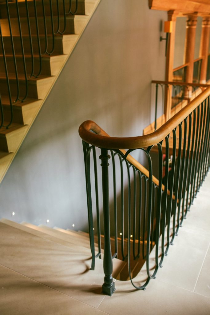 Country house bespoke staircase in stone and metal