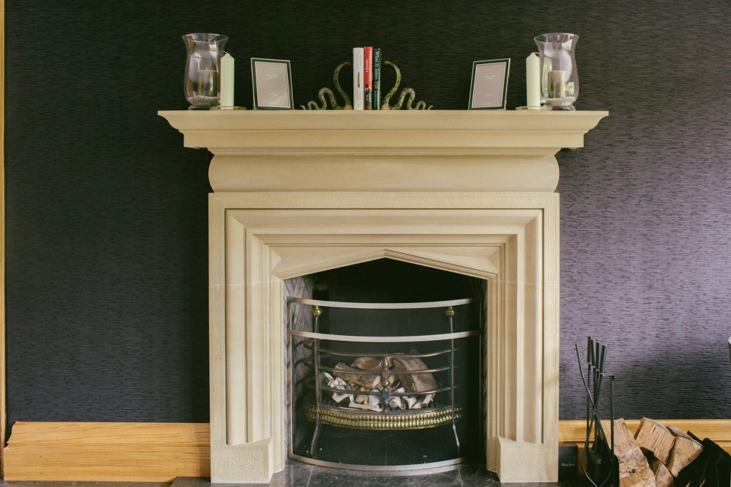 Classical Arts and Crafts stone fireplace surround