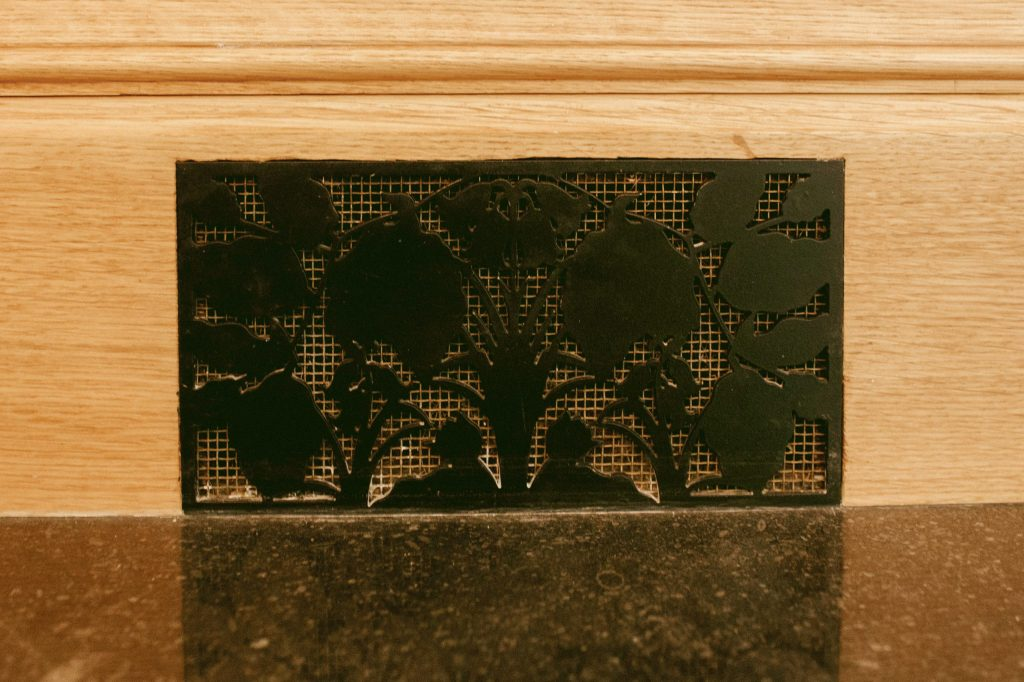 Bespoke metal vent cover in Oak skirting