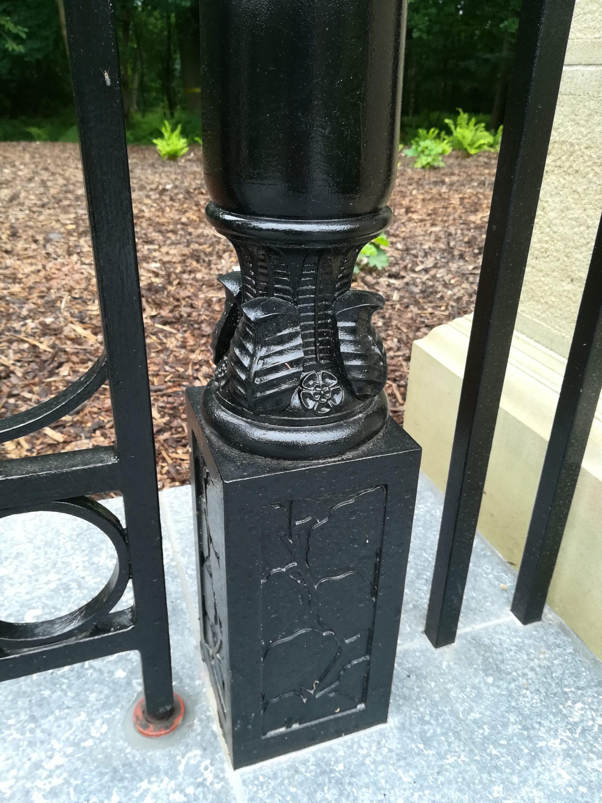 Metal garden gate post in Arts and Crafts garden