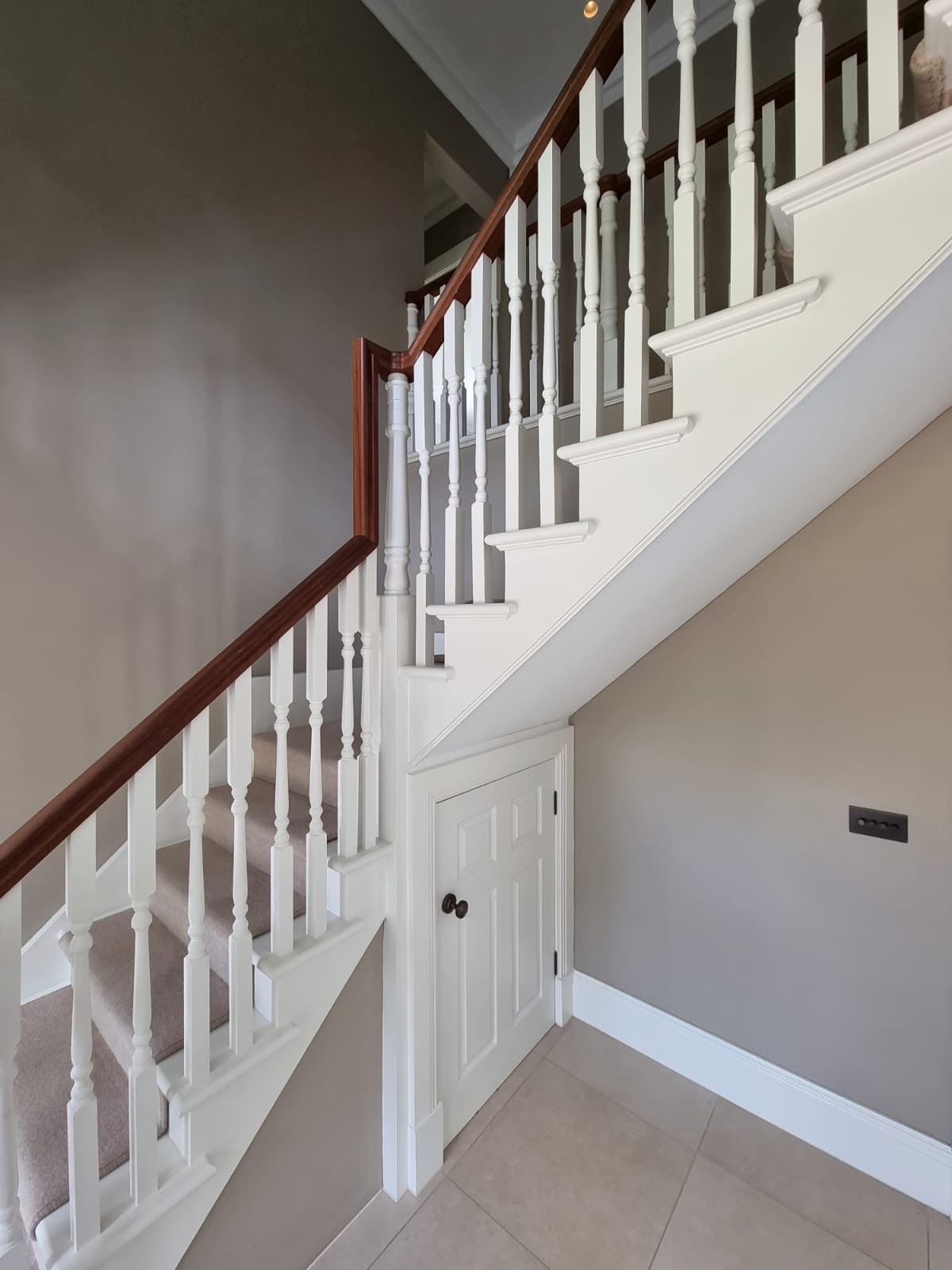 Timber staircase in hallway of large country house