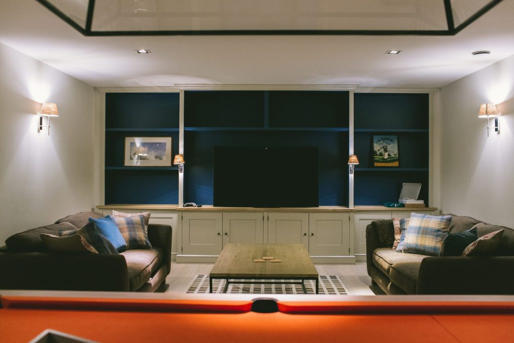 Private cinema and games room with fitted cabinets