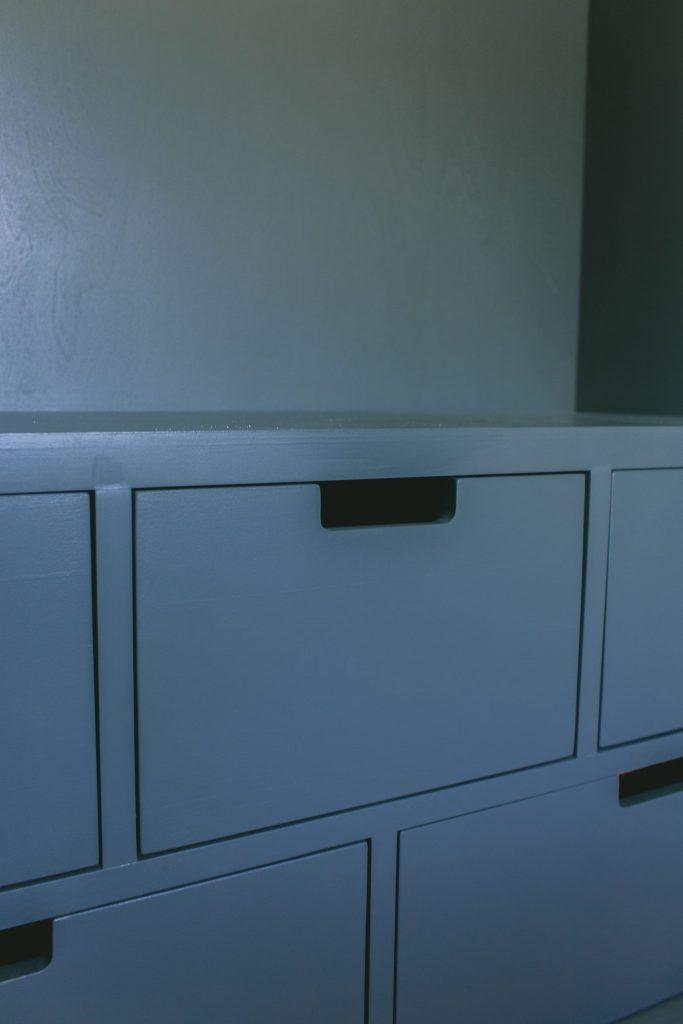 Navy blue drawers in contemporary bespoke wardrobe