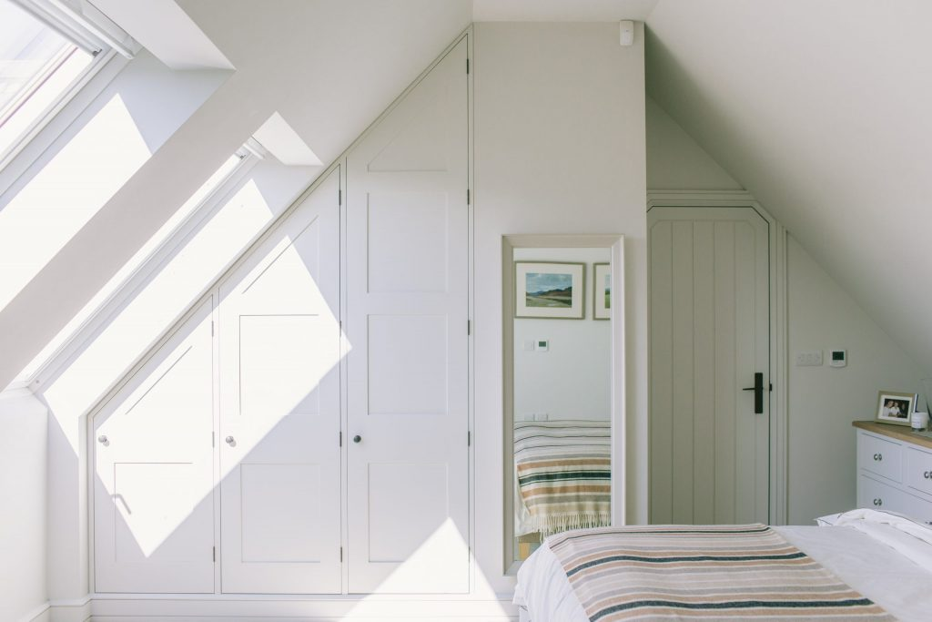 New house loft space bedroom with fitted wardrobes